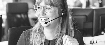 Lady wearing headset in a call centre
