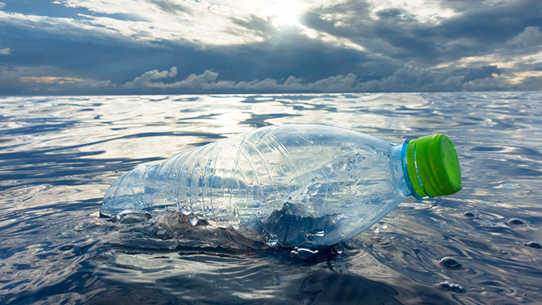 Plastic water bottle floating in ocean