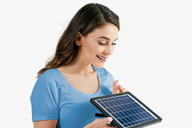 Feel Good Wealth Climate Action with a woman looking at a solar panel.
